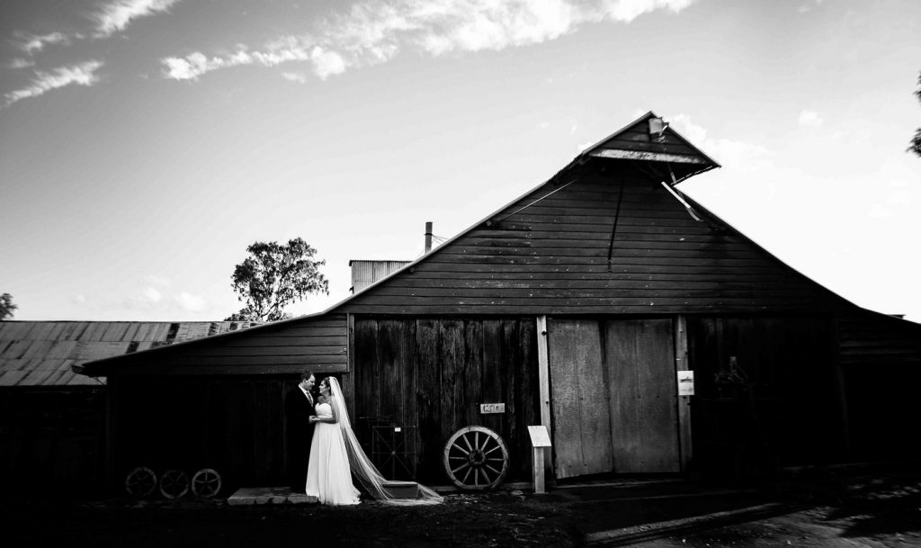 Wedding Photography Black & White in front of shed