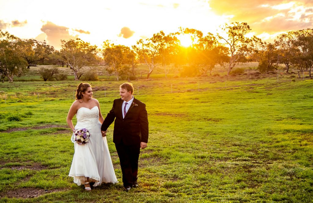 Wedding Photography couple in field at sunset