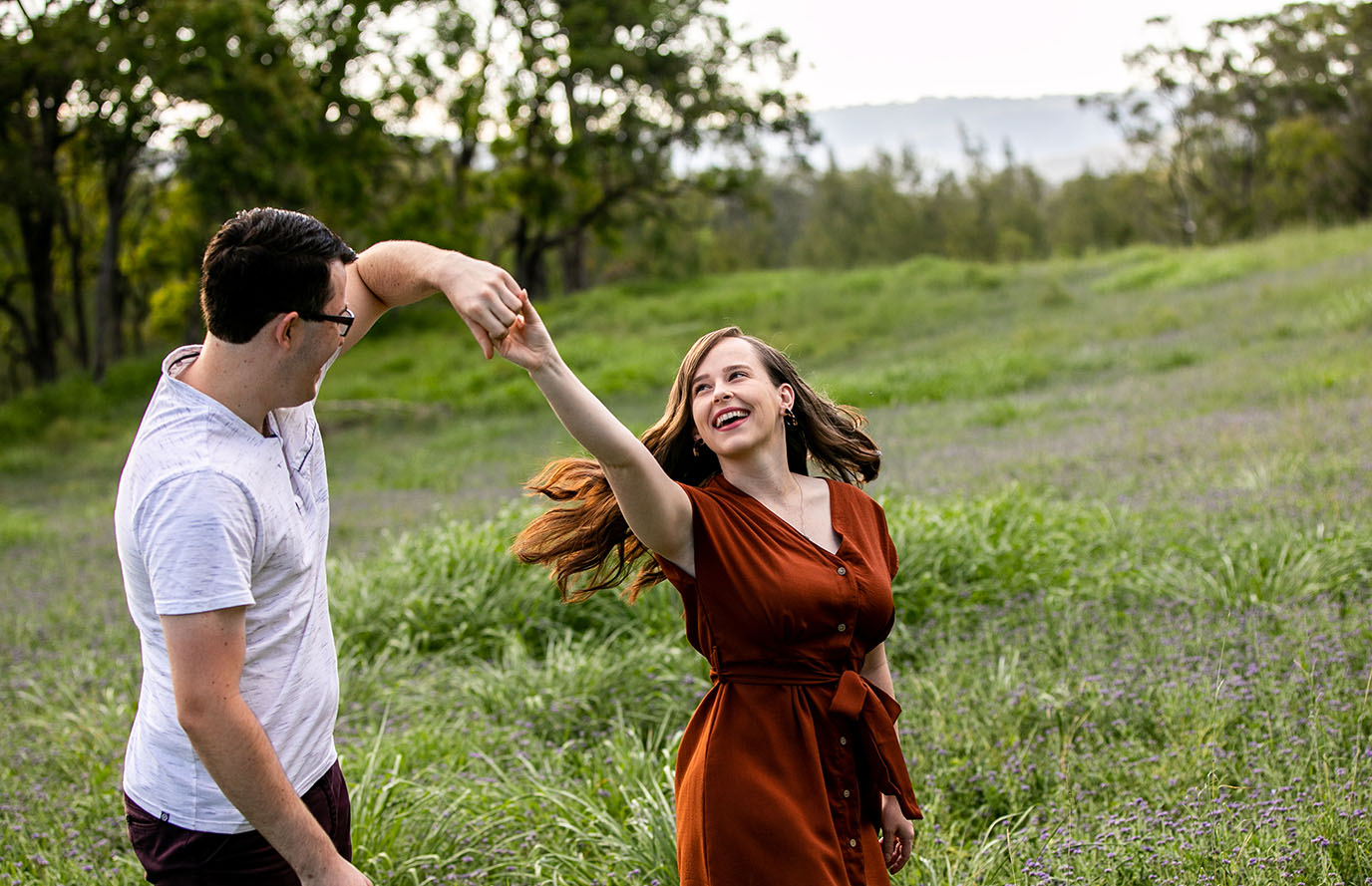 Engagement Shoot - couple dancing in field