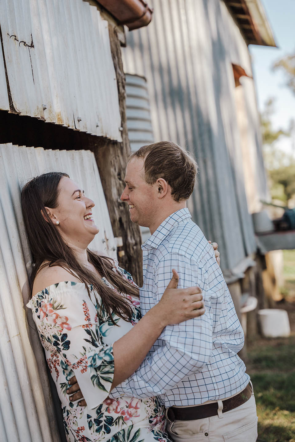 Engagement Photography - Couple leaning on shed