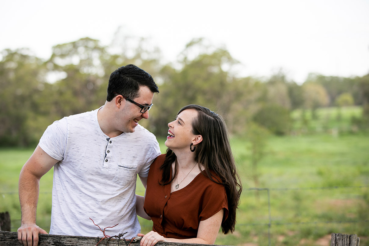 Engagement Shoot - couple laughing in field
