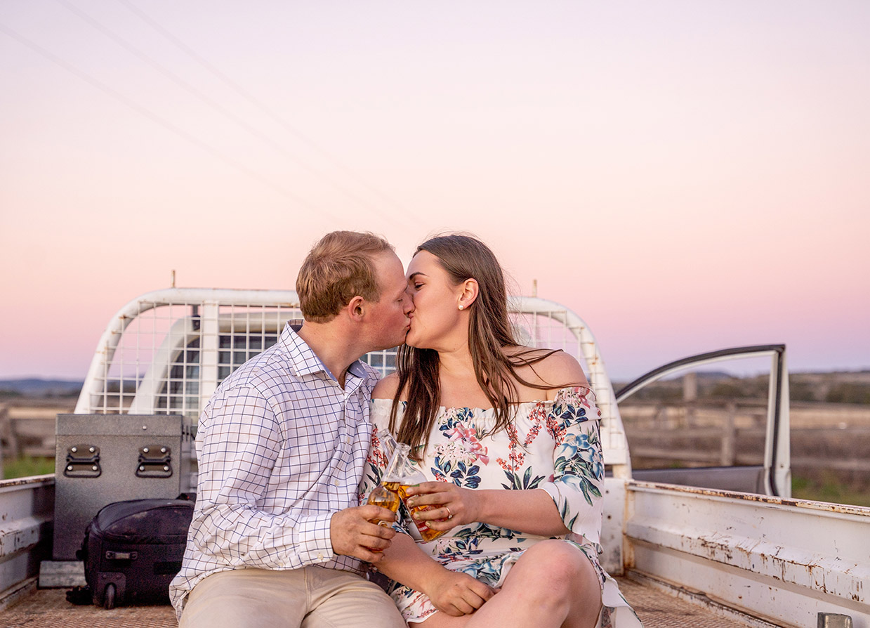 Engagement Photography - couple kissing on back of ute