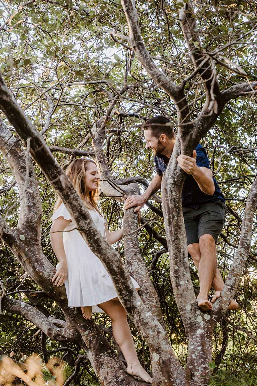 Engagement Photography - couple climbing tree
