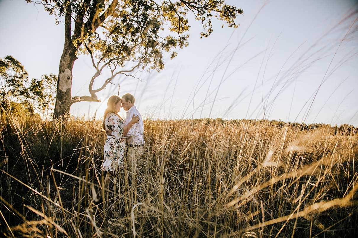 Engagement Photography - couple in grassy field