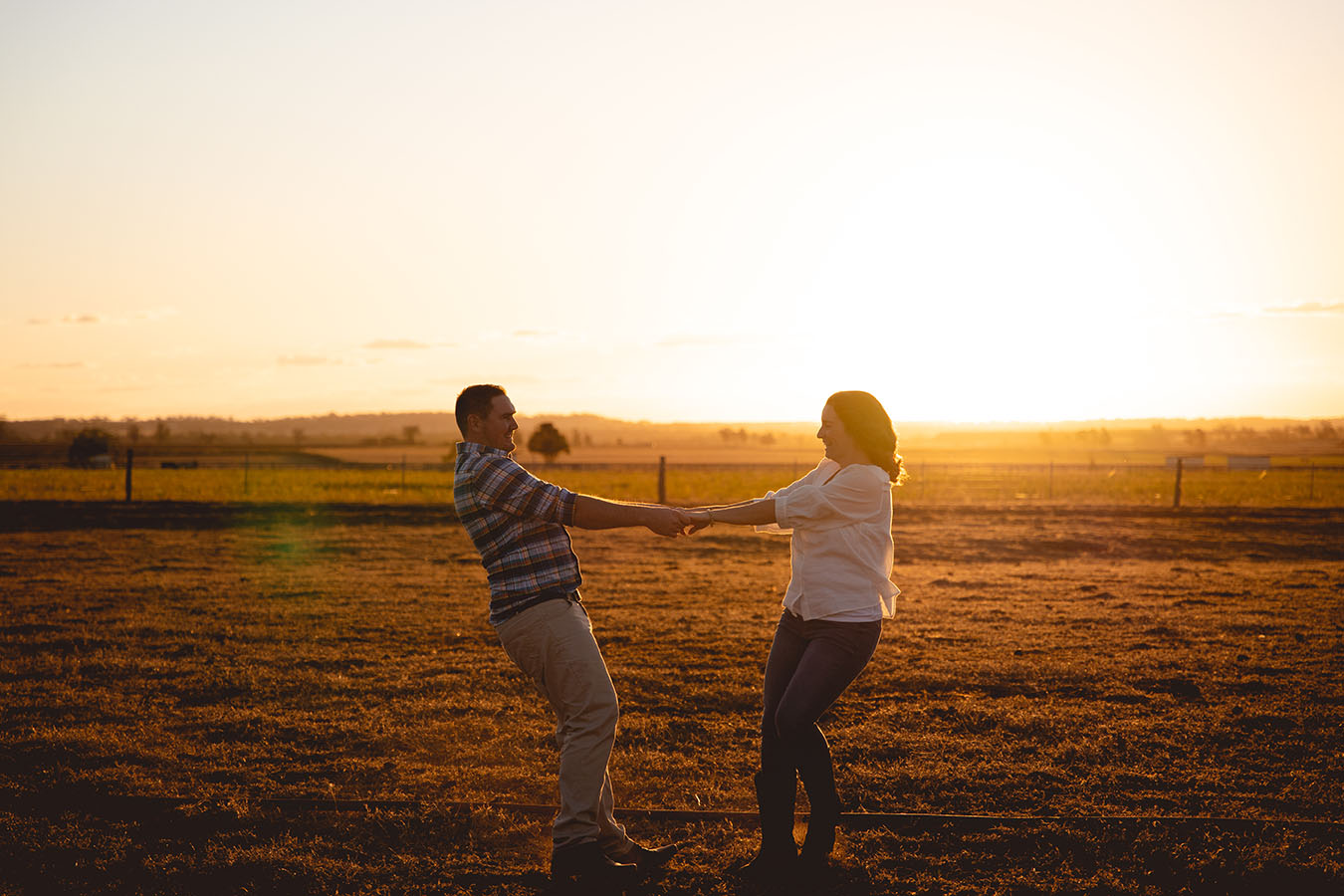 Engagement Photography - couple in field dancing