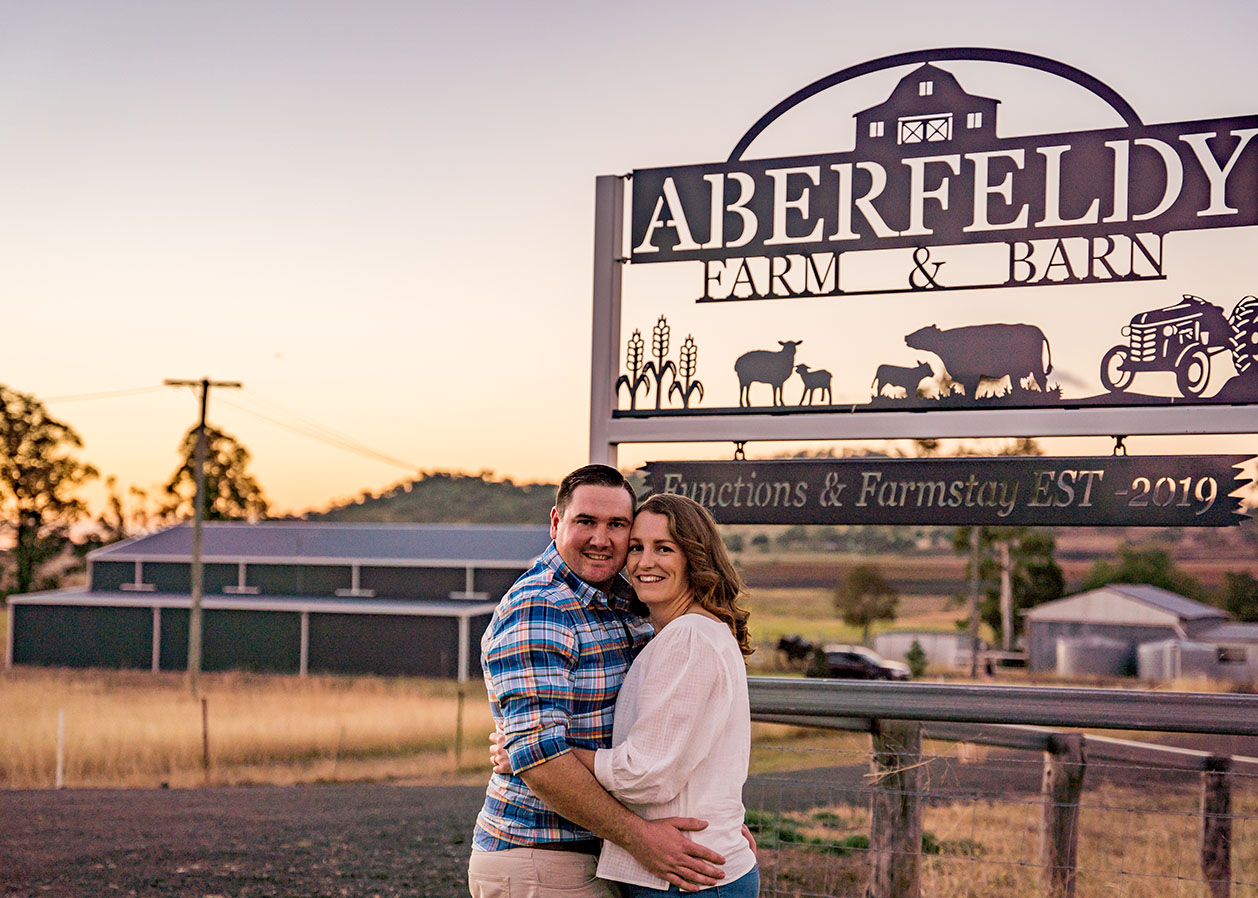 Engagement Photography - couple in front of farm sign