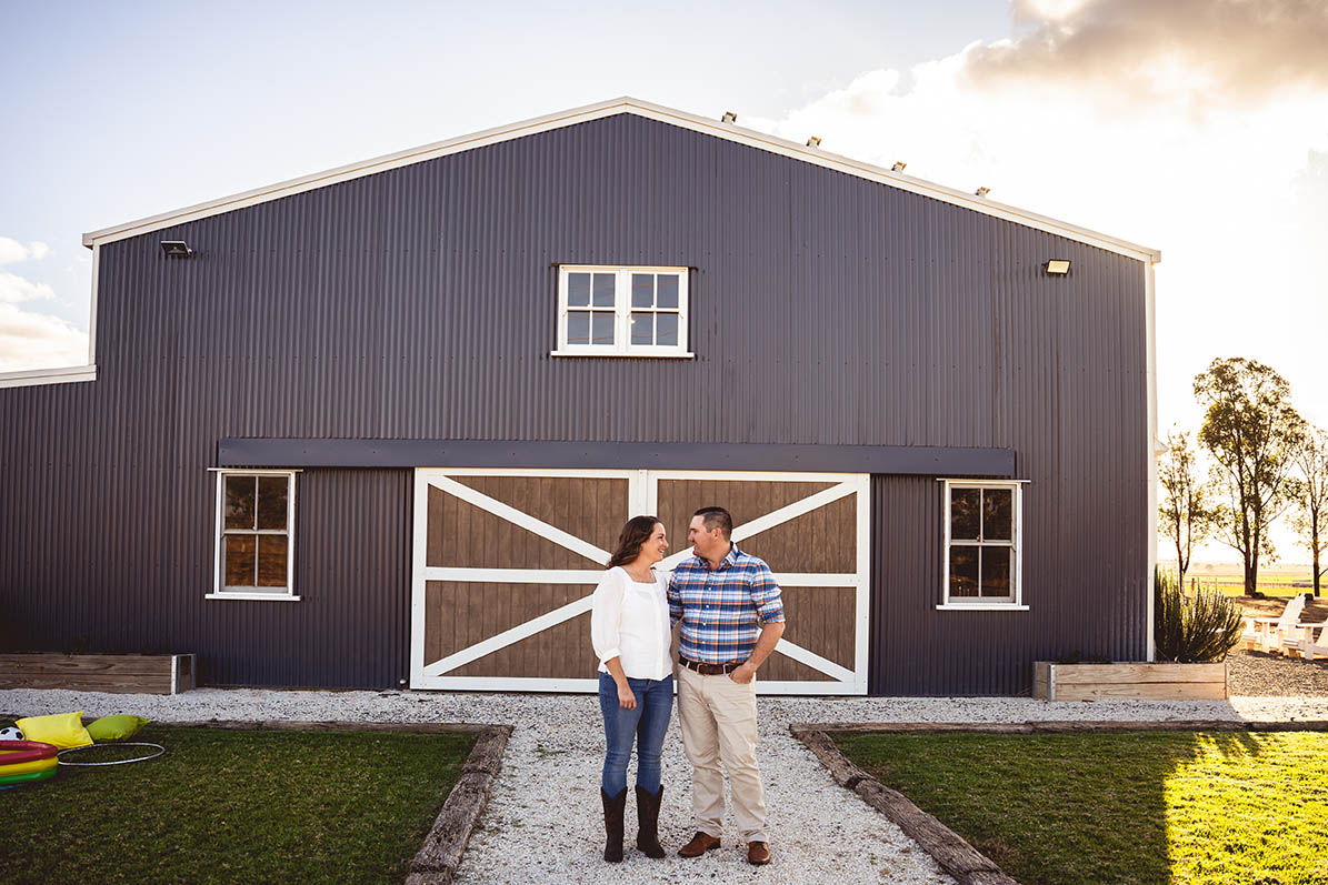 Engagement Photography - couple in front of barn