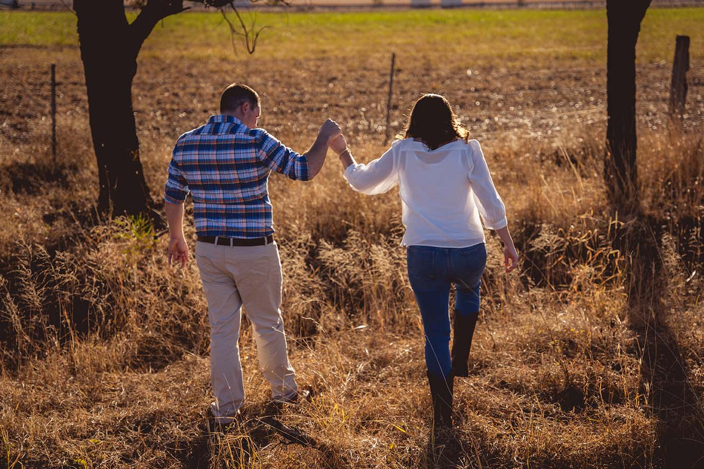 Engagement Photography - couple walking holding hands