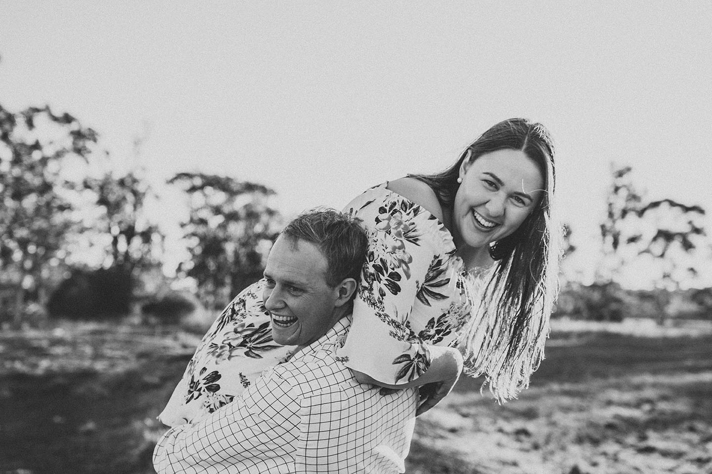 Engagement Photography - Fiance being carried black and white