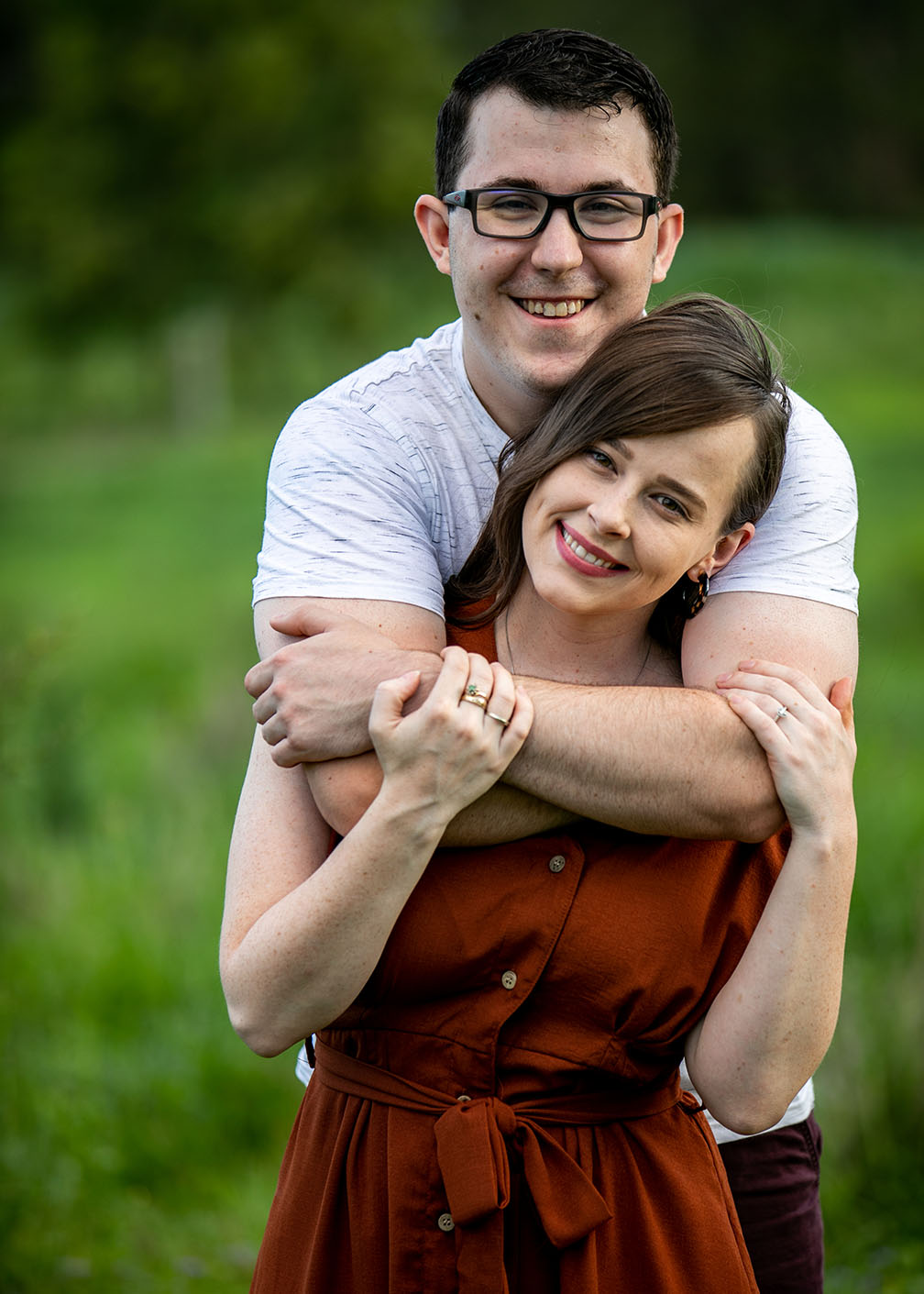 Engagement Shoot - couple cuddling in field