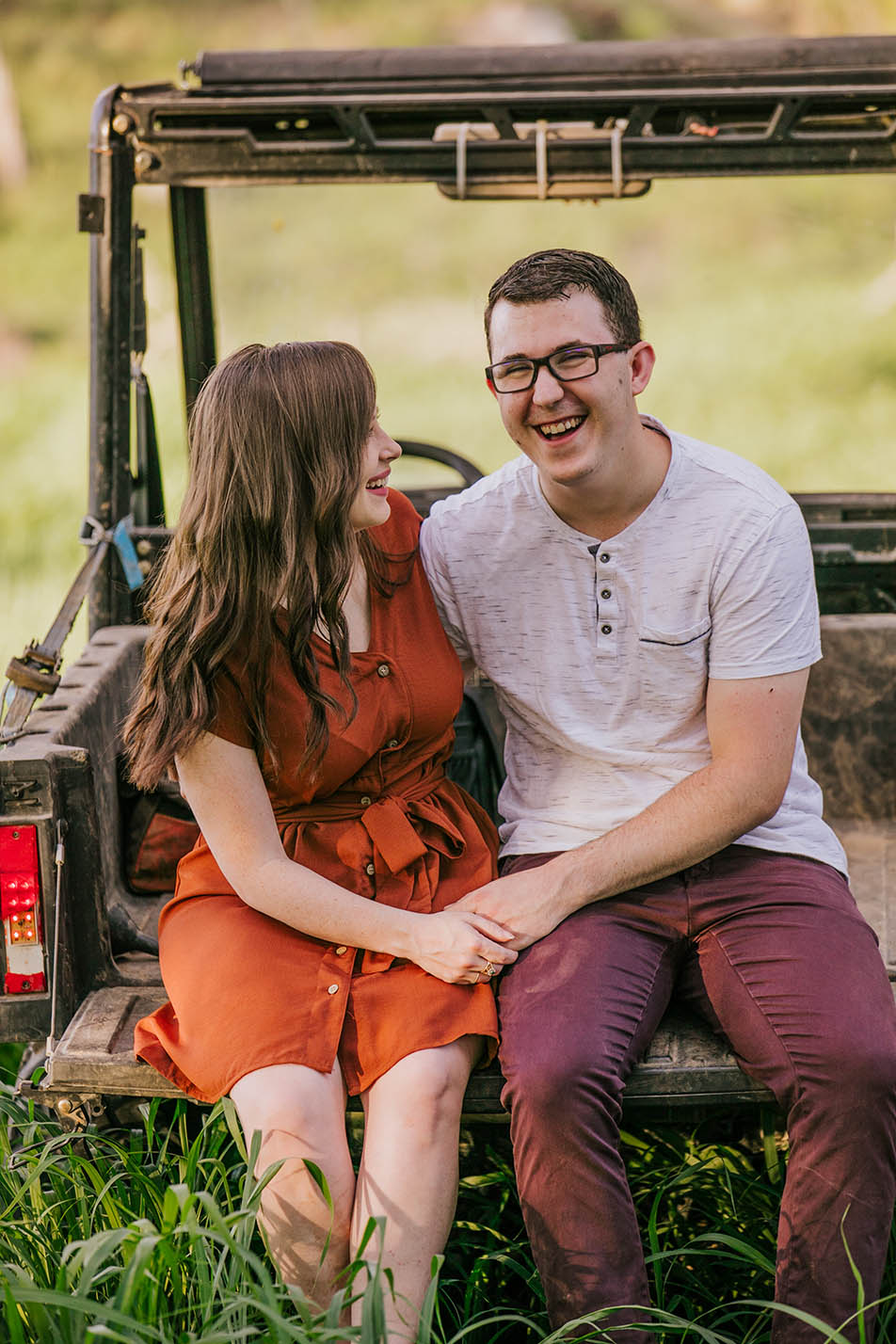 Engagement Photography - couple holding hands on rustic car