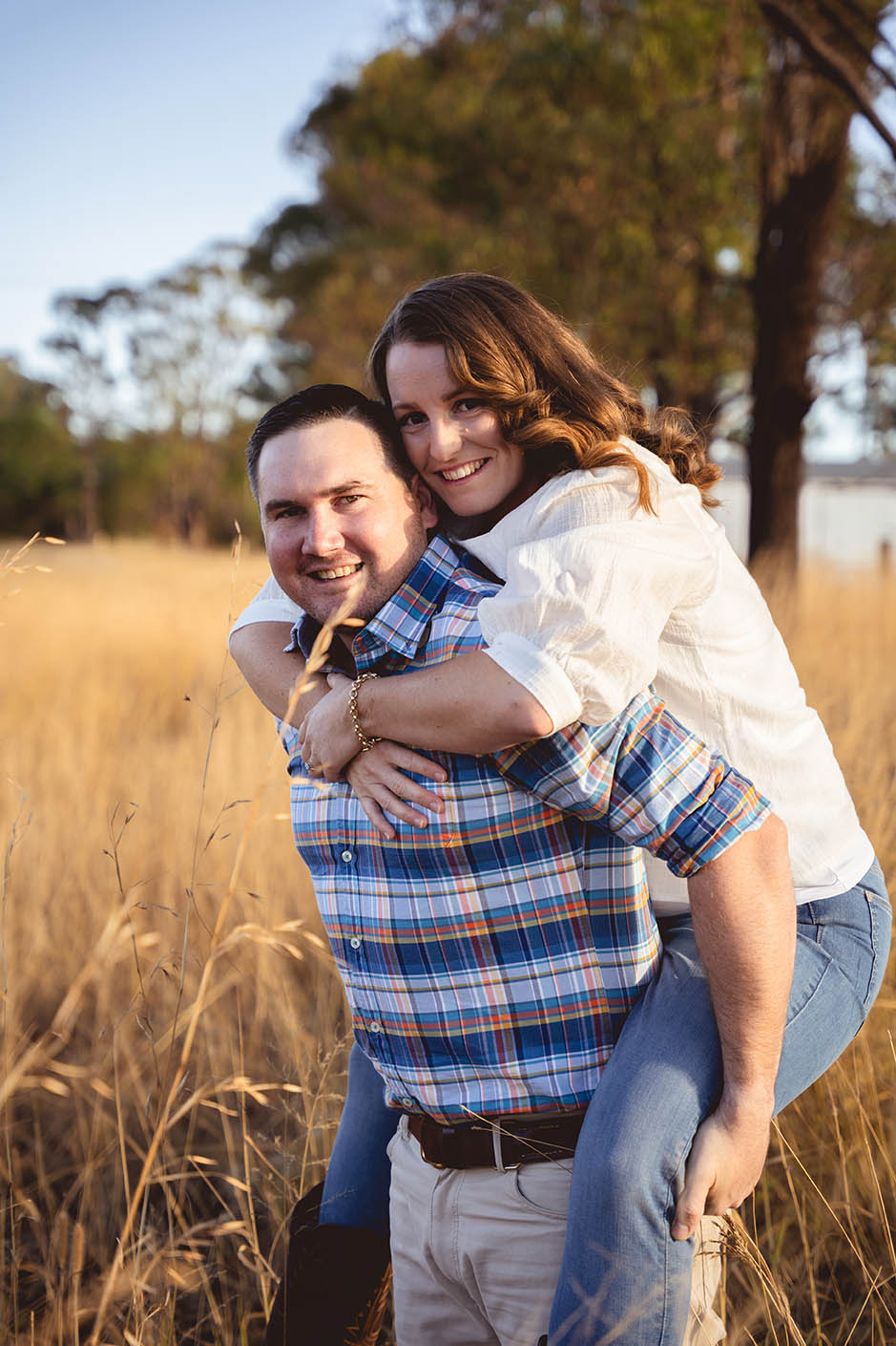 Engagement Photography - couple in field, fiance being carried