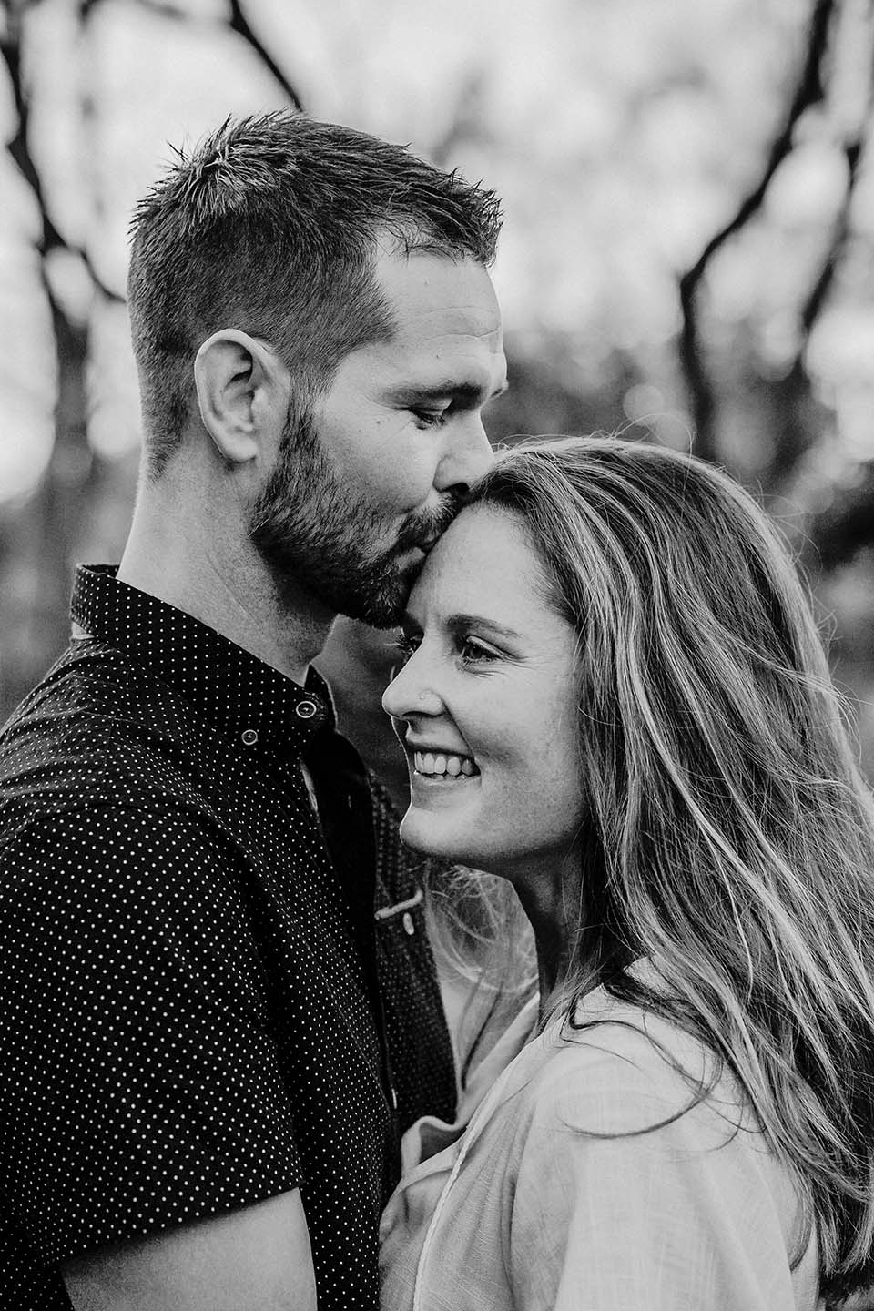 Engagement Photography - couple kiss on forehead black and white