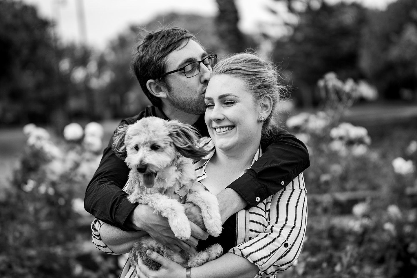 Engagement Photography - couple in park with dog black and white