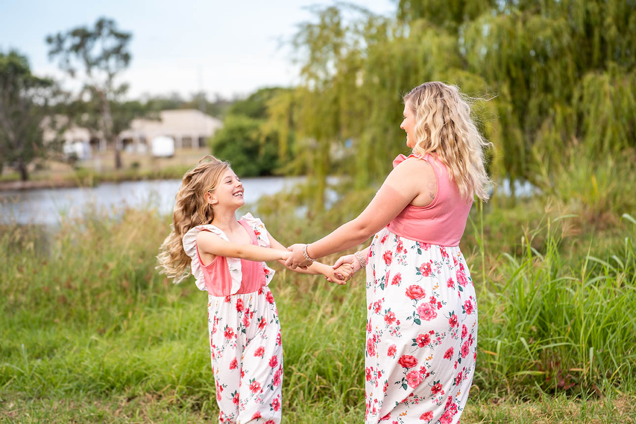 Maternity Photography - Mother and Daughter Dancing in field