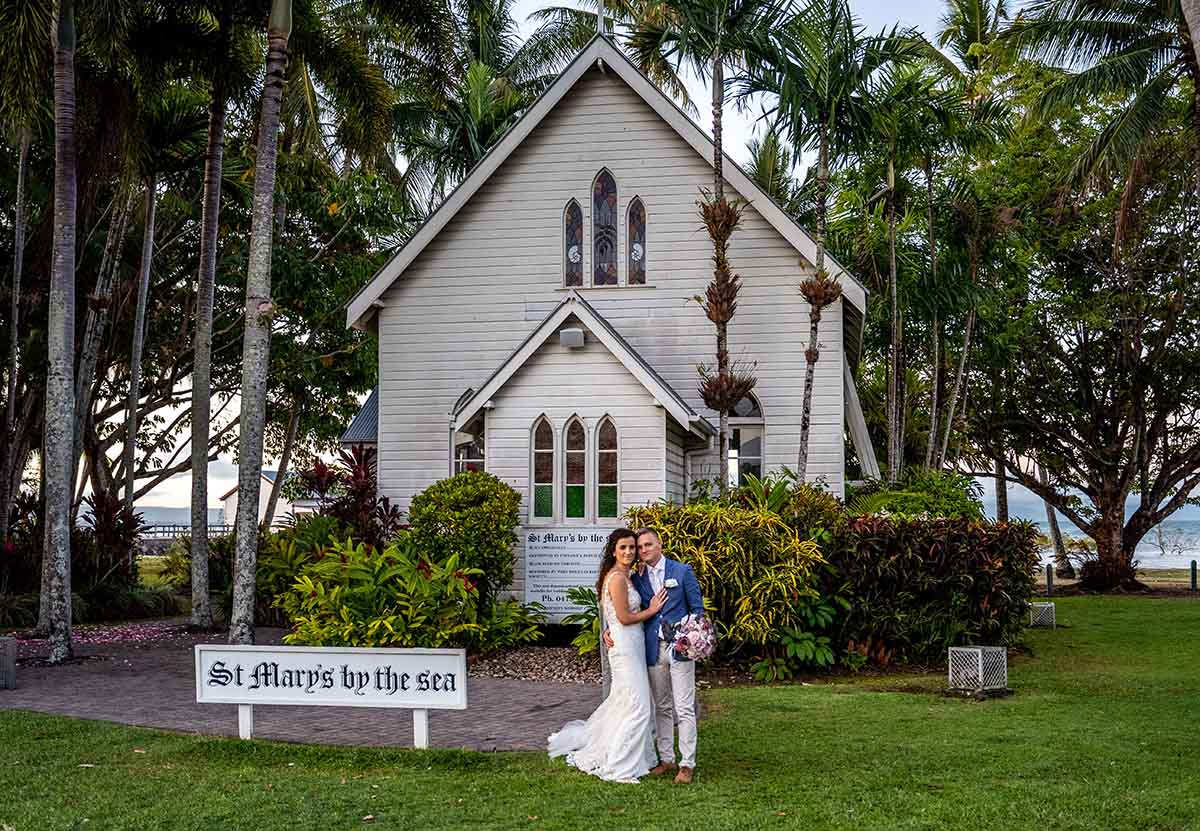 Destination Wedding Photography - couple in front of church