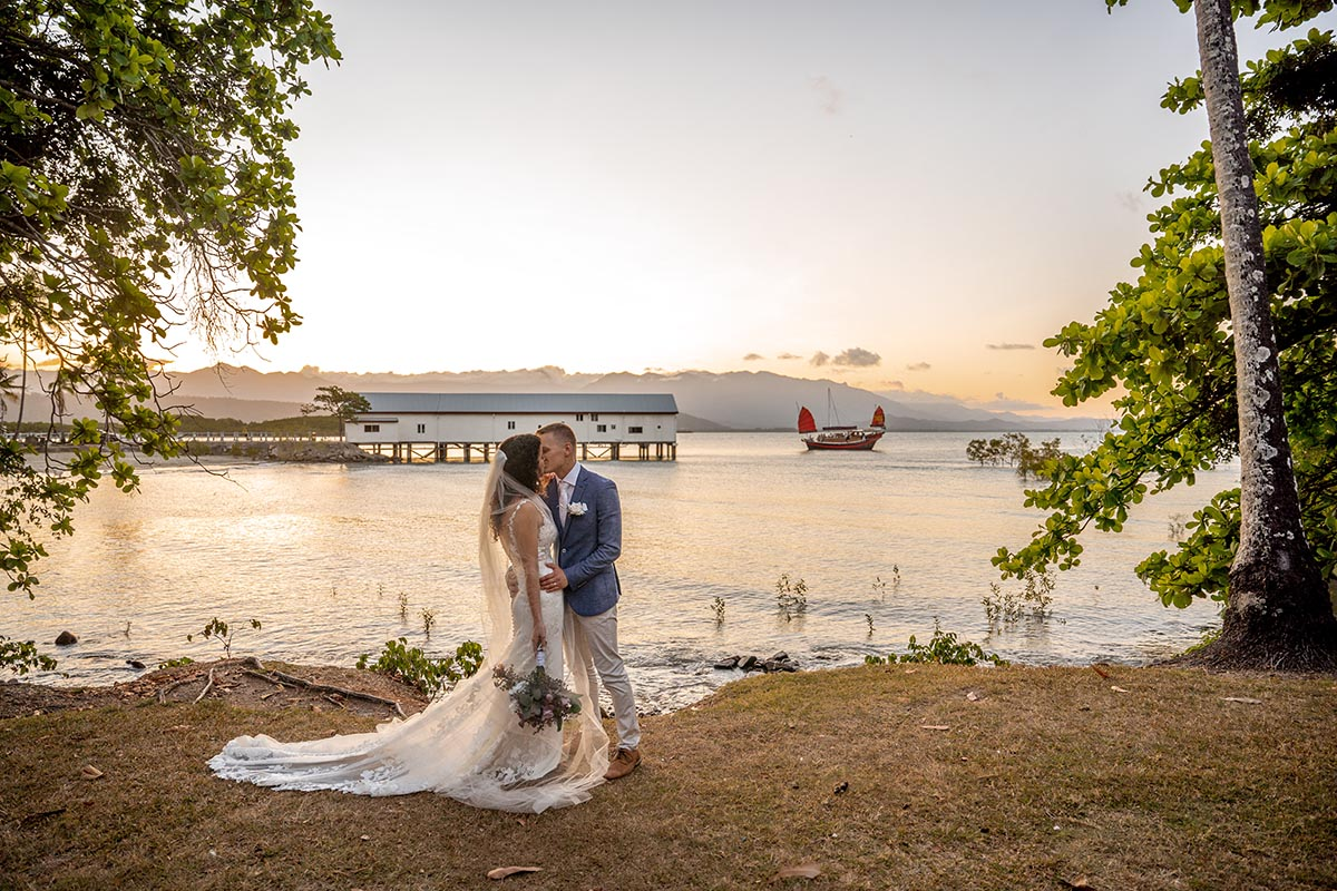 Destination Wedding Photography - couple in front of water