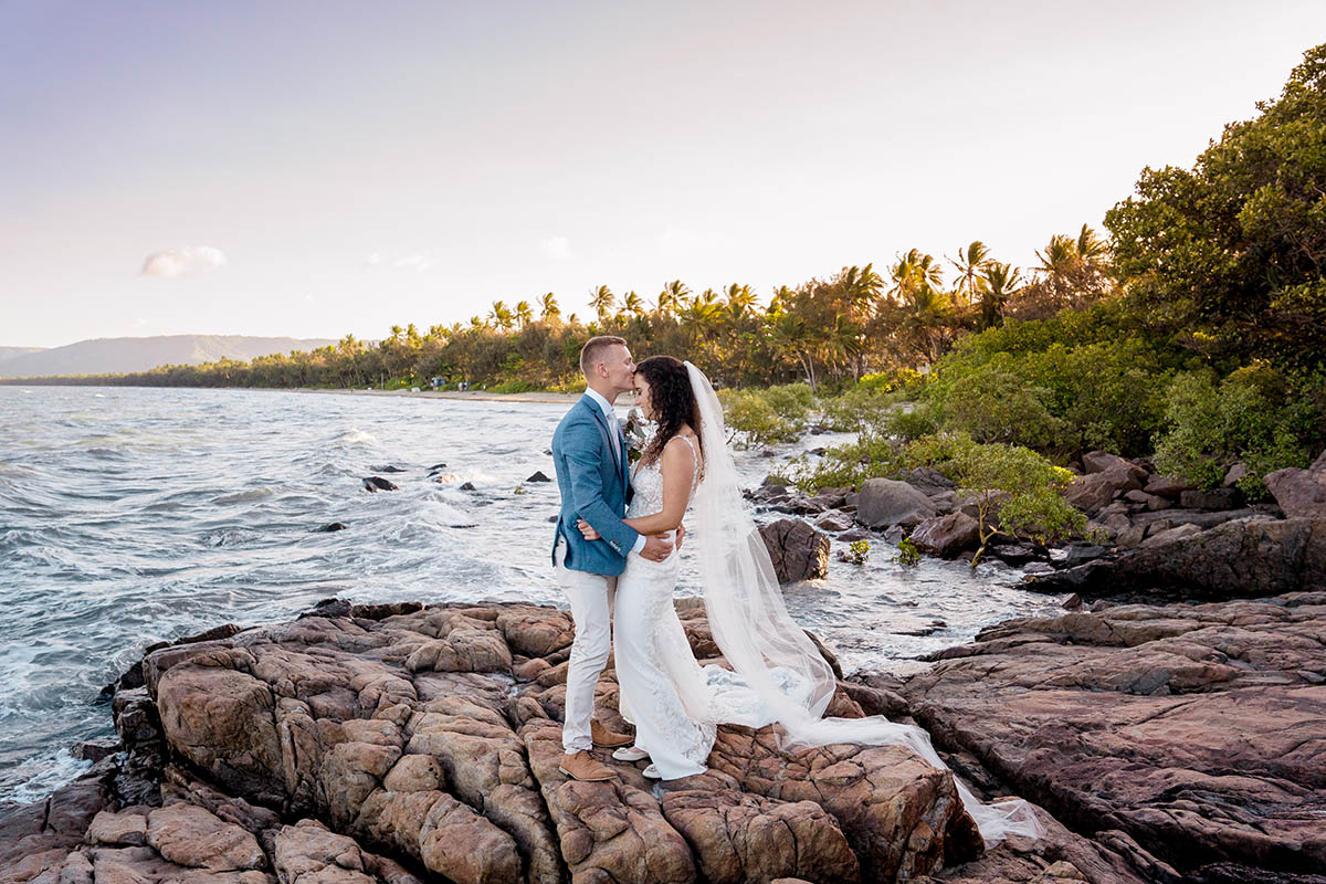 Destination Wedding Photography - couple on rocks in front of ocean