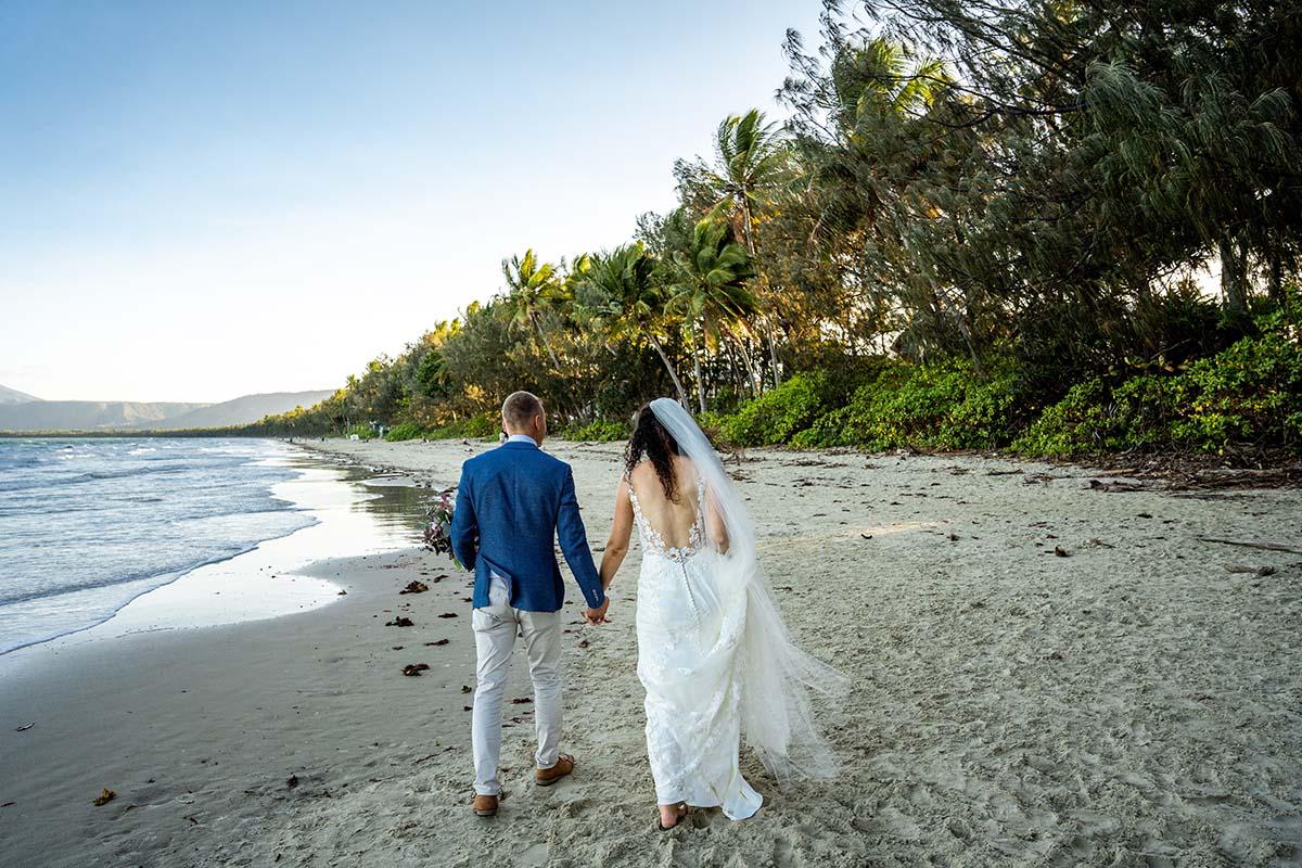 Destination Wedding Photography - couple walking on beach