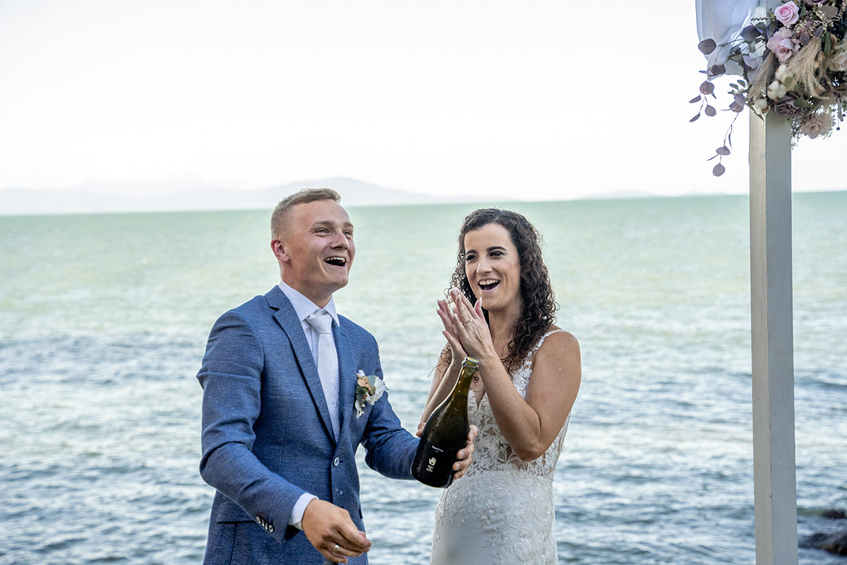 Destination Wedding Photography - popping champagne
