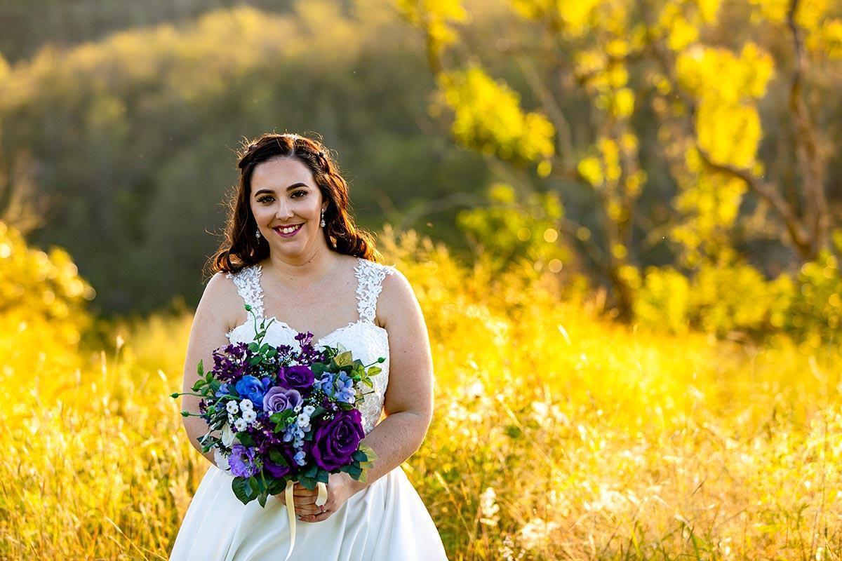 Wedding Photography - beautiful bride in grassy field