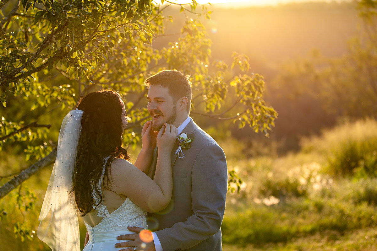 Wedding Photography - couple embracing in field
