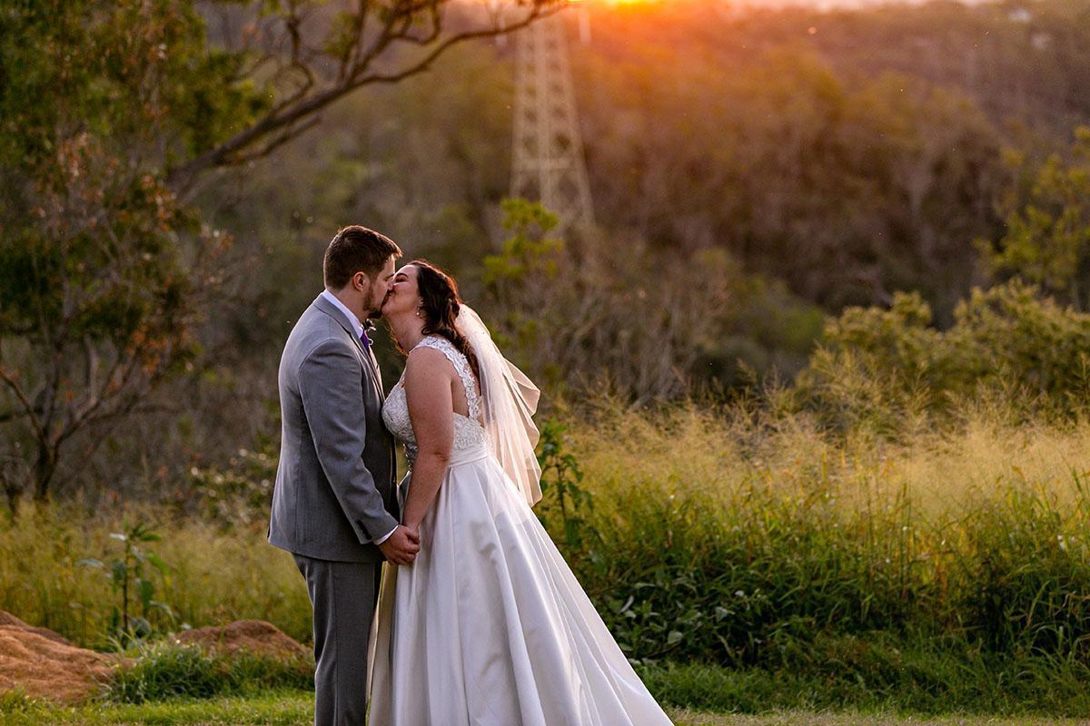 Wedding Photography - couple kissing at sunset