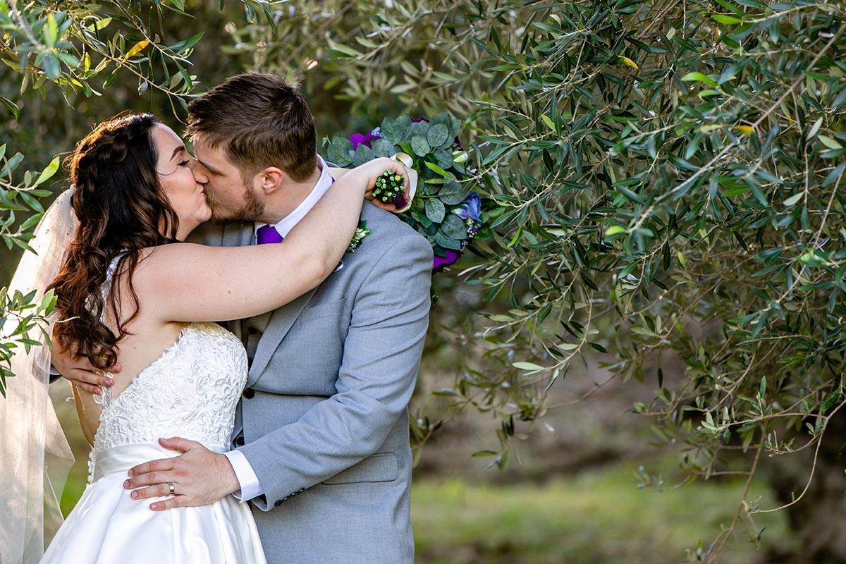 Wedding Photography - kissing under tree