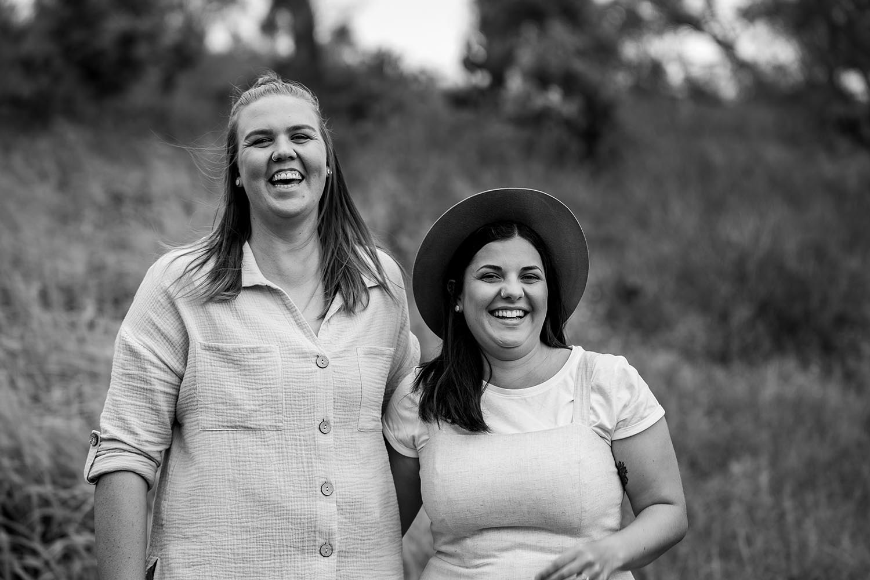 Engagement Photography - couple laughing black & white