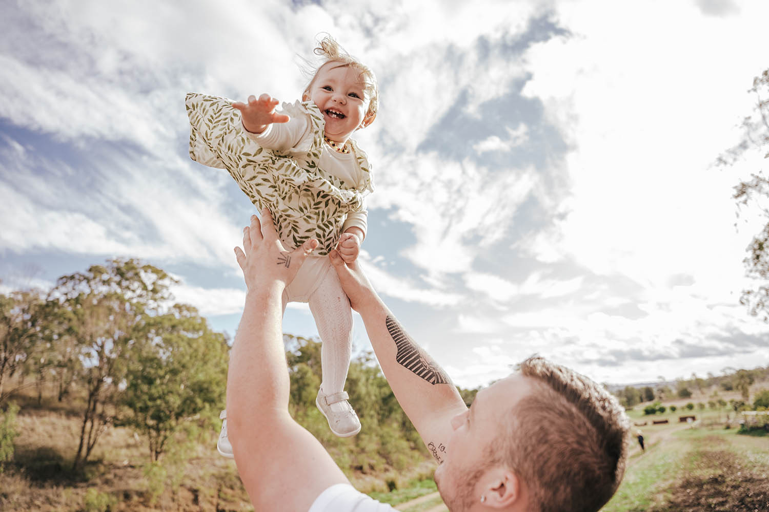 Family Photography - father throwing daughter