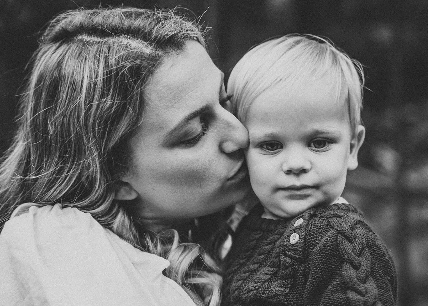 Family Photography - mother kissing sons cheek