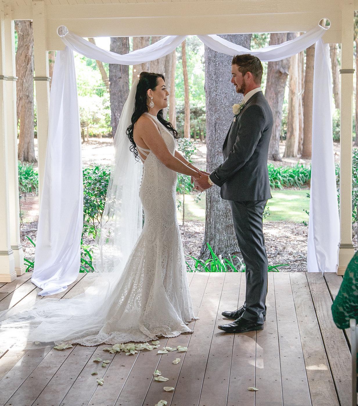 Wedding Photography ceremony holding hands