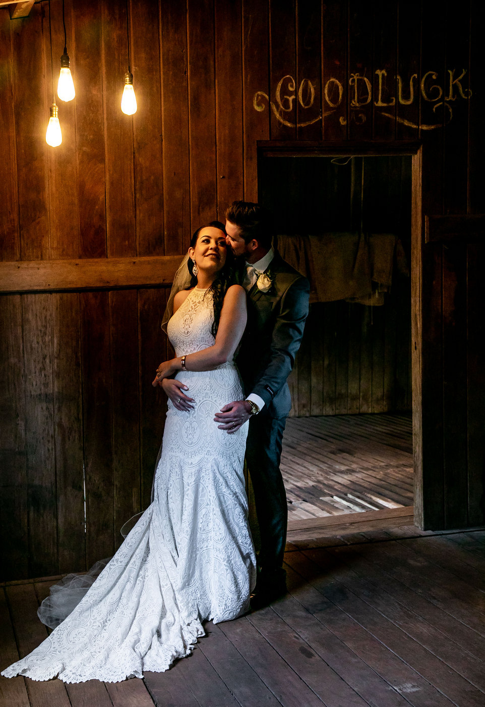 Wedding Photography couple embracing in rustic cottage