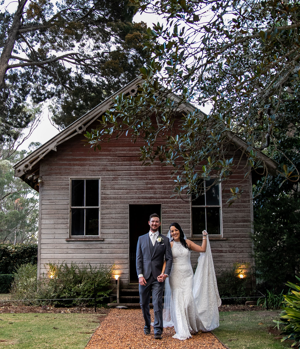 Wedding Photography couple in front of cottage