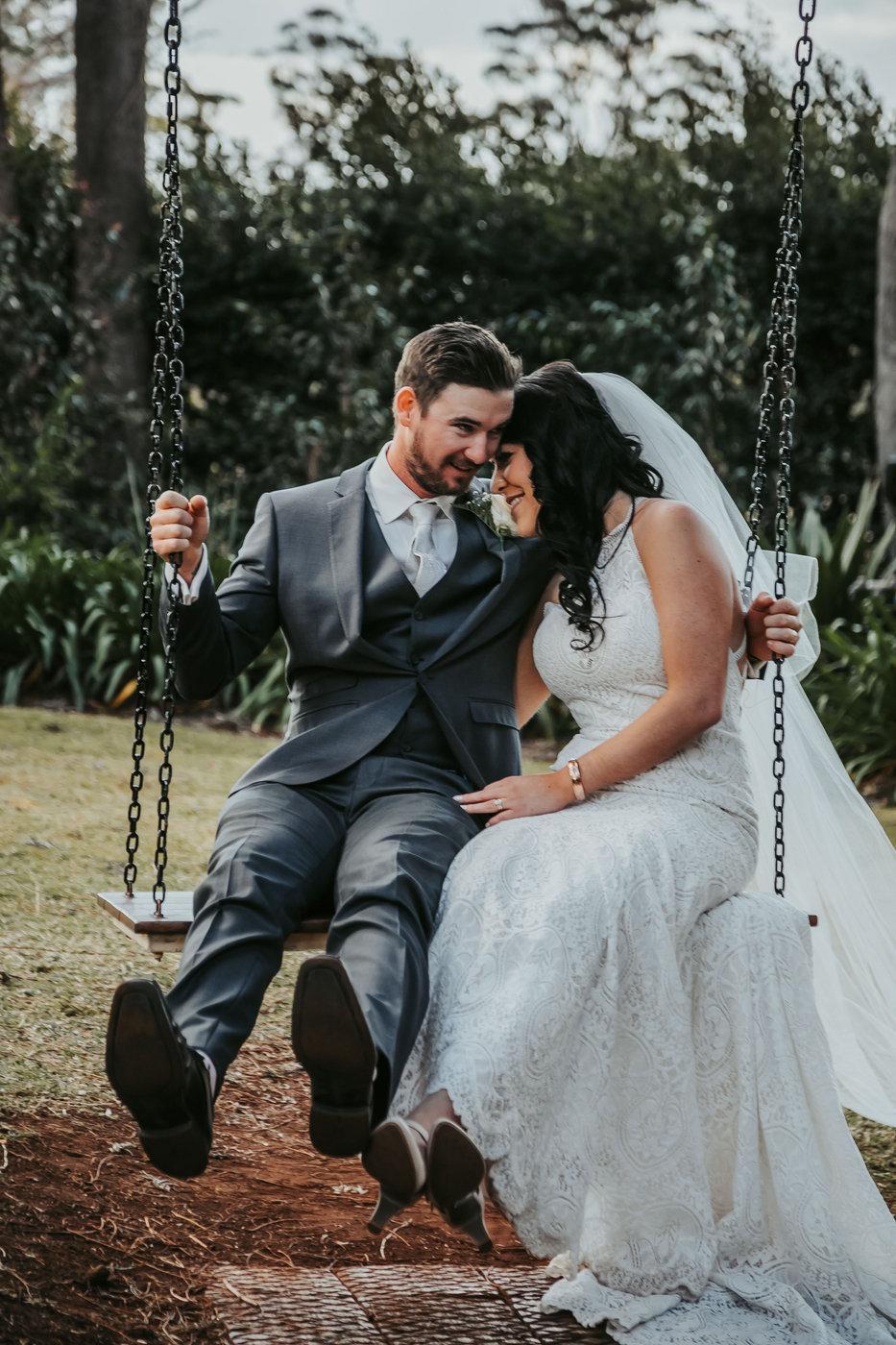 Wedding Photography couple on swing