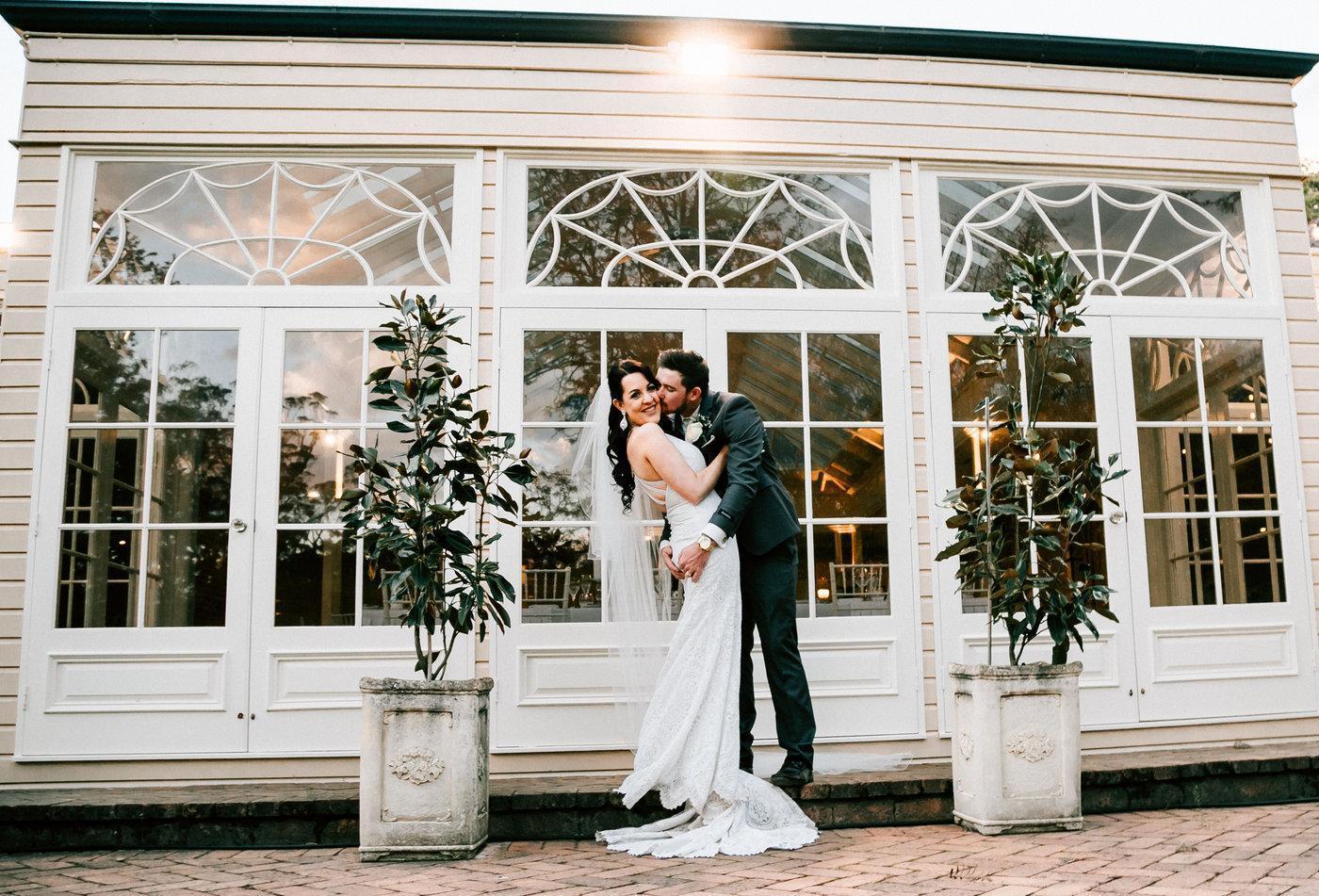 Wedding Photography husband kissing wife's cheek