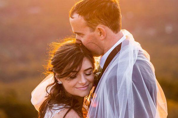 Wedding Photography Couple Embracing at Sunset
