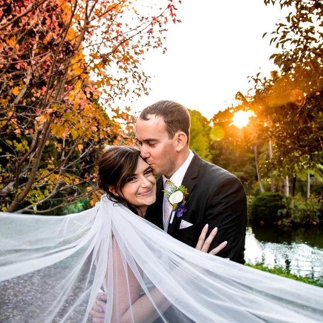 James& Megan Wedding Photography Couple Embracing with flowing veil