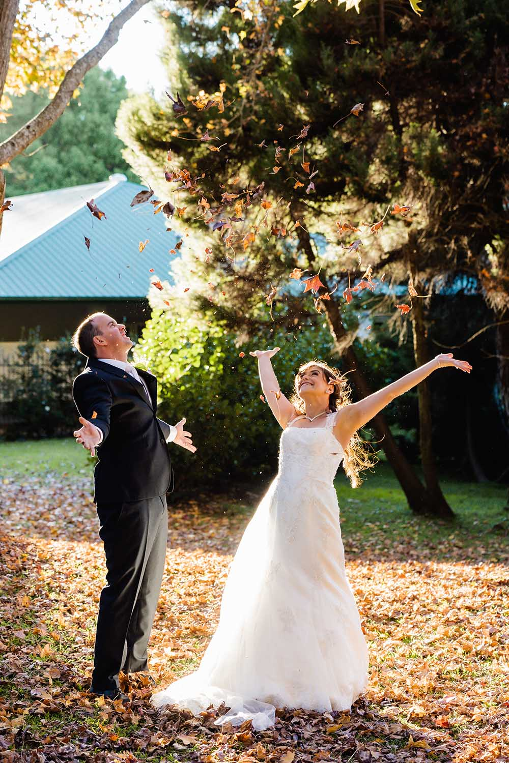 Wedding Photography Couple Throwing Leaves