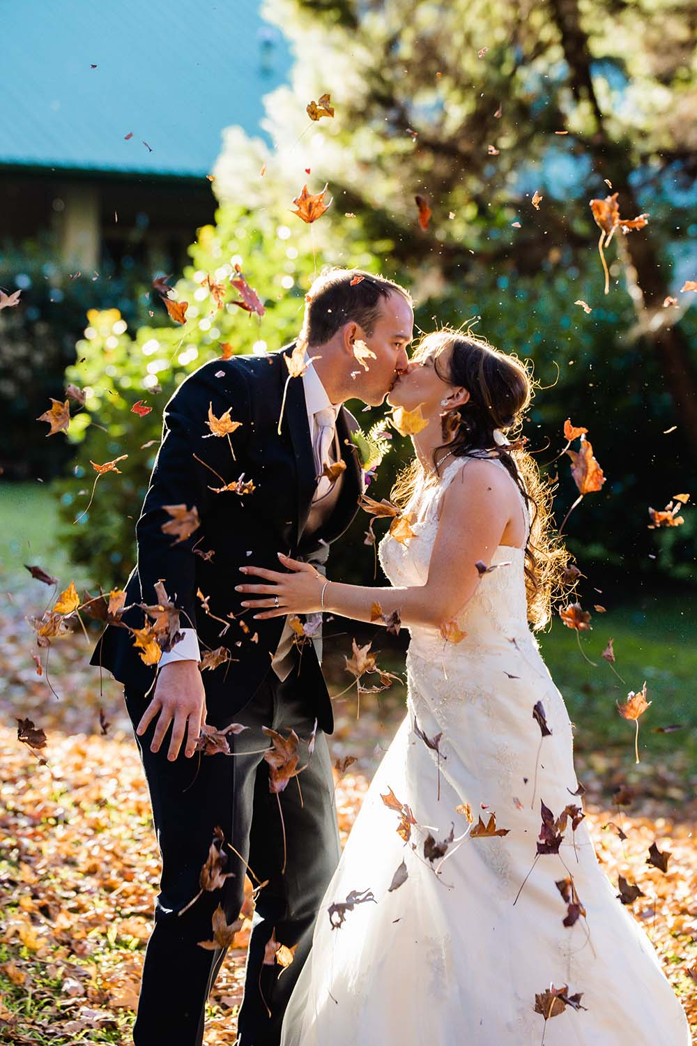 Wedding Photography Couple Kissing under falling leaves