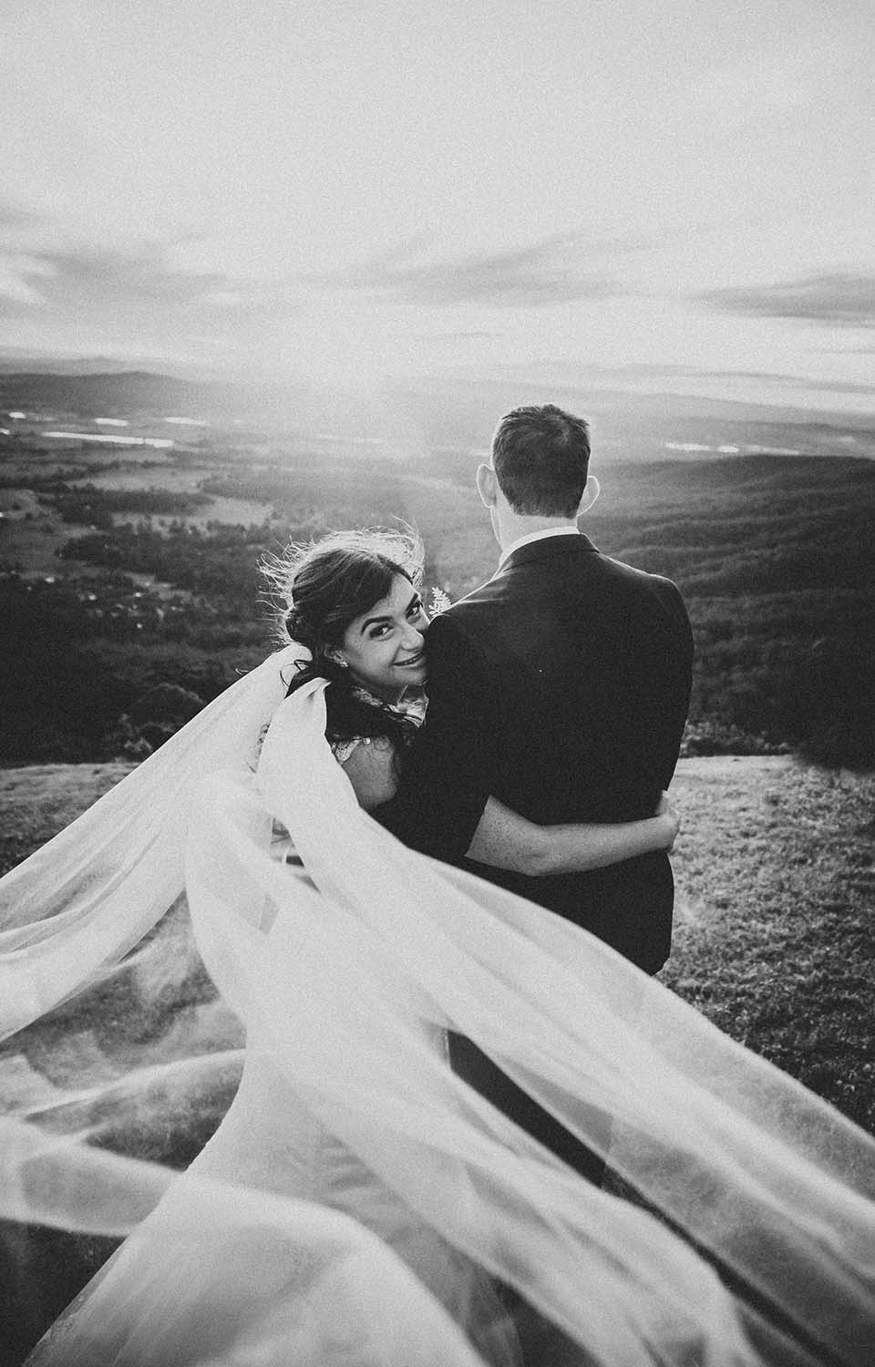 Wedding Photography Flowing Veil with couple embracing black and white