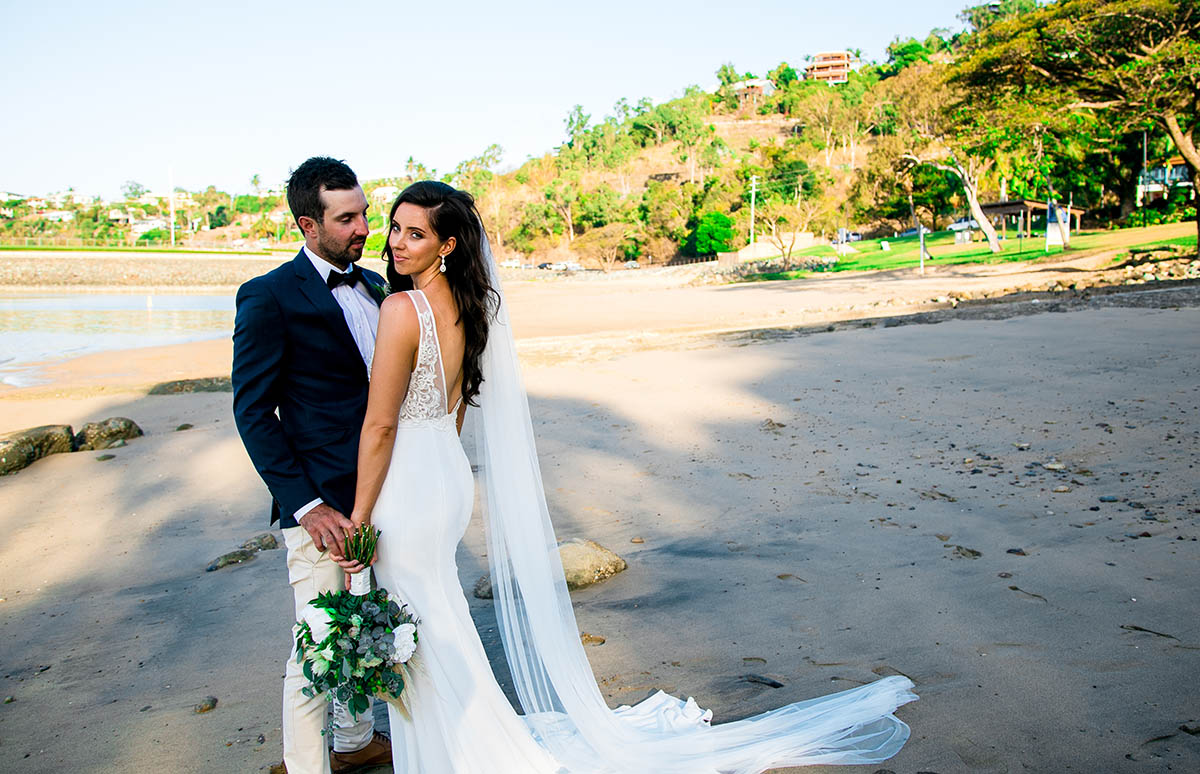 Wedding Photography - couple in front of water