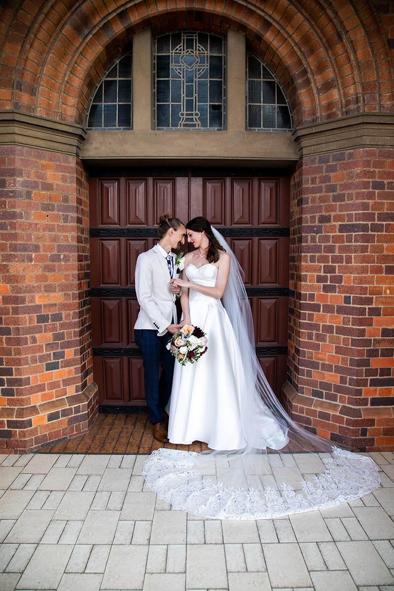 Wedding Photography - Ceremony Couple in front of Church door