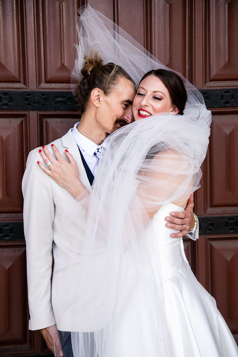 Wedding Photography - Couple embracing after ceremony