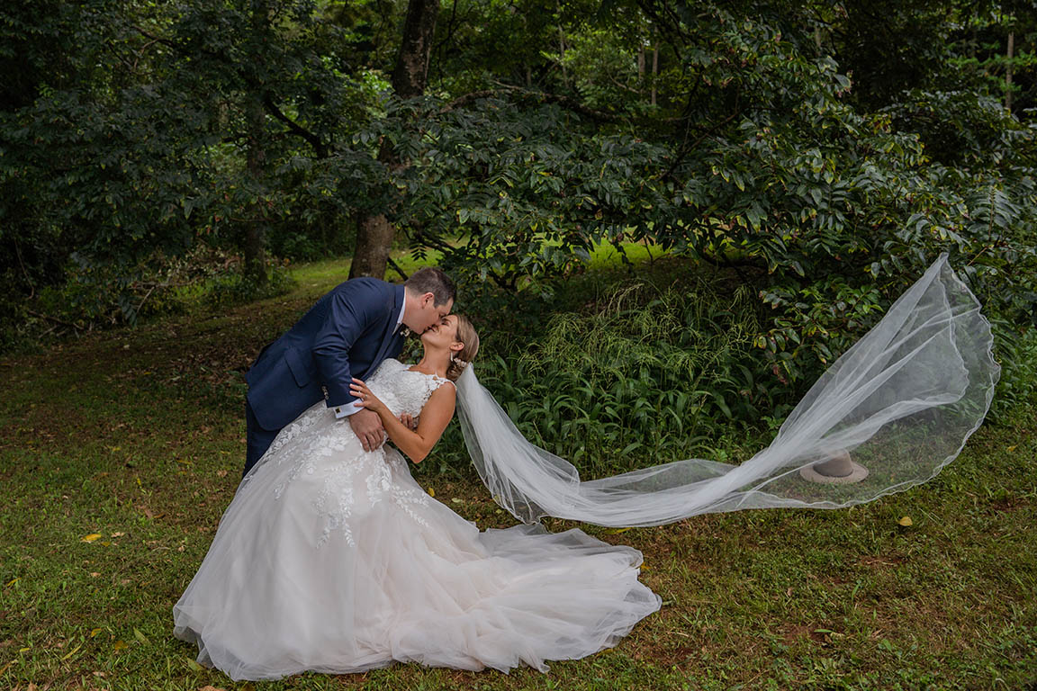 Wedding Photography - husband dipping wife