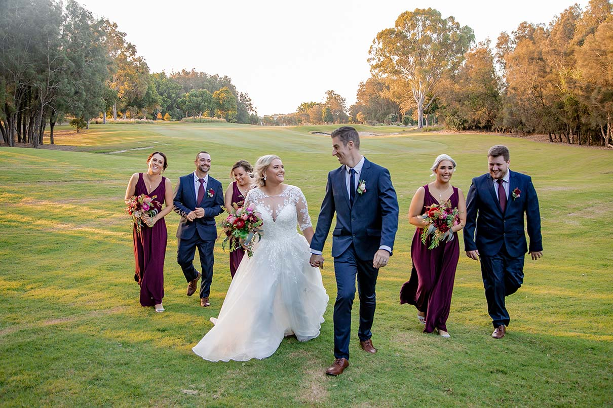Wedding Photography - bridal party walking