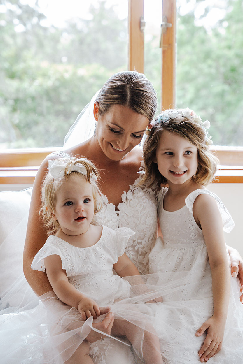 Wedding Photography - Bride and flower girls cuddling