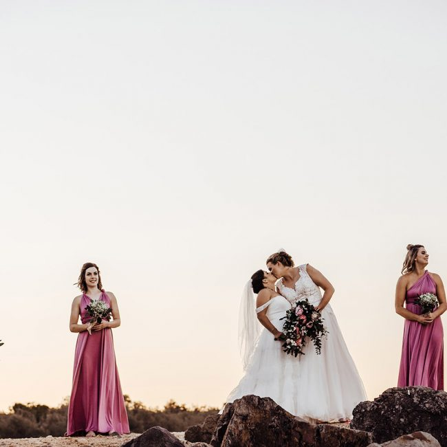 Wedding Photography - Bridal party on the rocks at the beach
