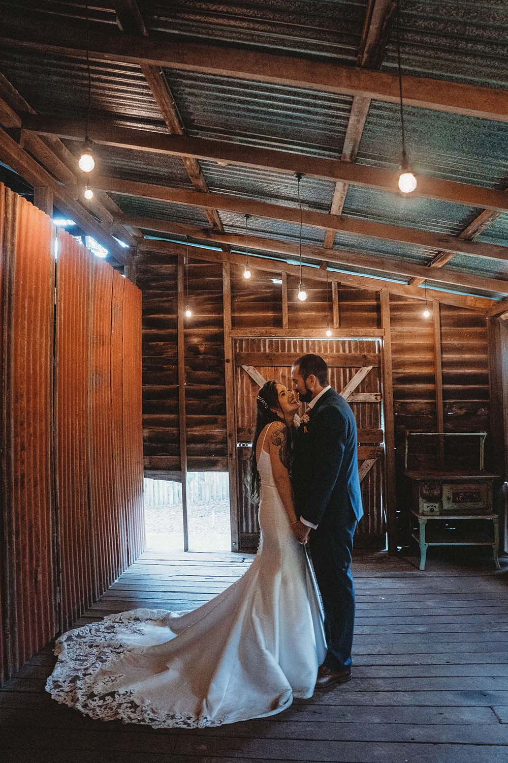 Wedding Photography - Bride and Groom in rustic room