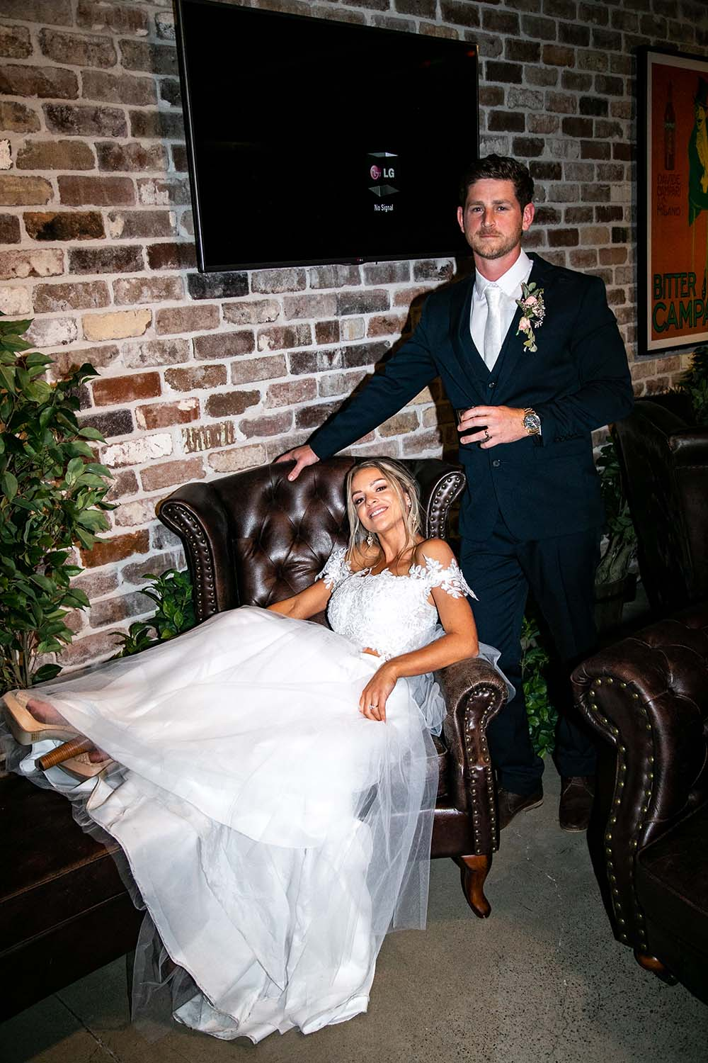 Wedding Photography - Bride in chair and groom
